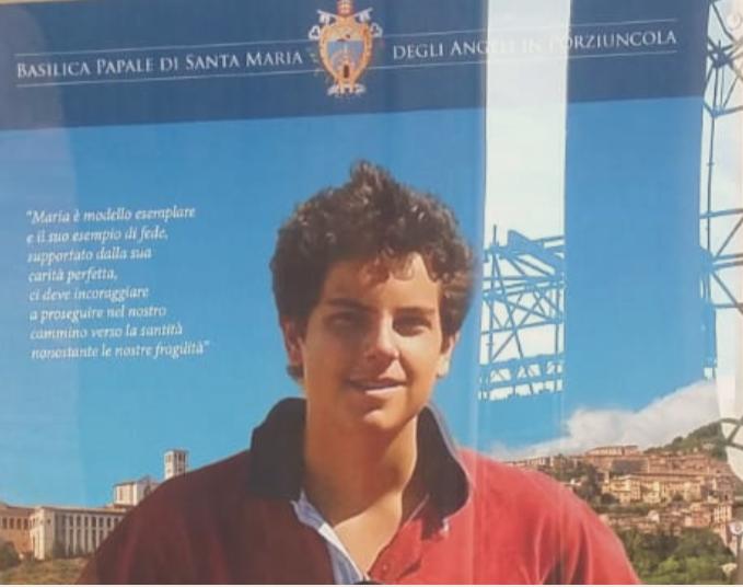 Carlo Acutis manifesto mostra apparizioni mariane in Assisi